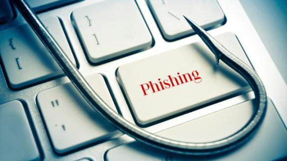 Phishing-fish hook on computer keyboard