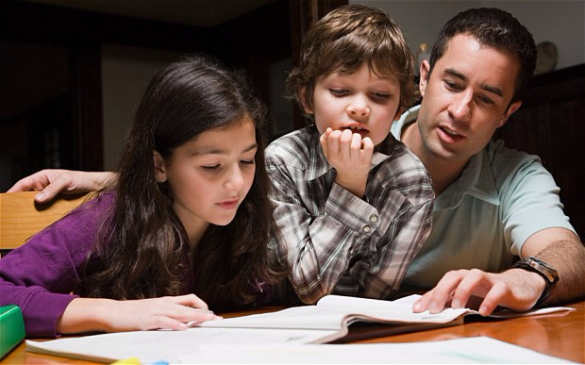 Dad helping daughter and son with homework_Weebly