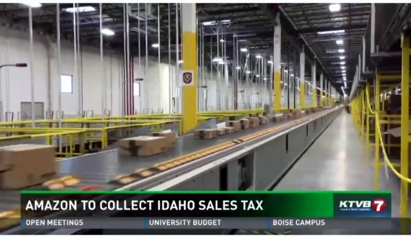 Amazon boxes on distribution center conveyer belt_KTVB Boise report screen shot