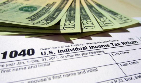1040-tax-return-and-cash-771x578