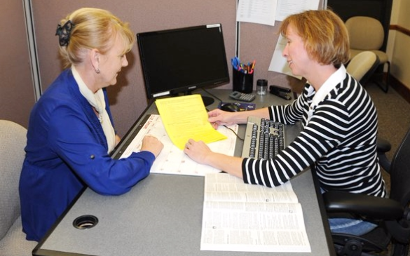 Tax preparer helping a client_US Army photo