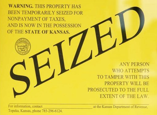 Kansas real property seizure notice